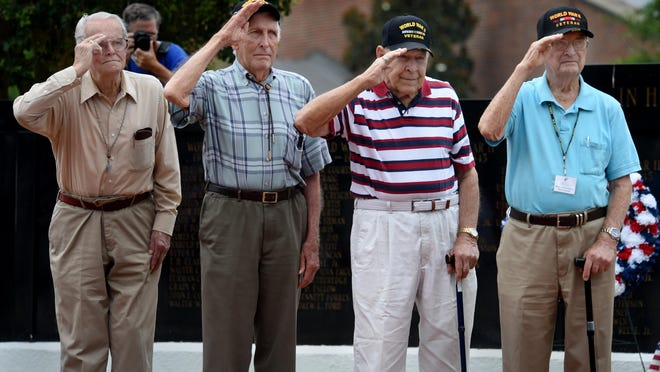 """World War II veterans Walter """"Sonny"""" Clemons (from left), N.L. Caprell, Howard Neleigh and Vernon Derrick salute during the playing of """"Taps"""" at the Aiken County Veterans Park during the D-Day Remembrance Ceremony in Aiken on June 6, 2019."""