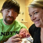 Kurt and Holly Ray with New Year's baby Kennedy.
