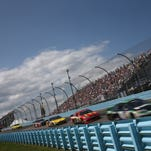 Denny Hamlin leads a pack of cars through Turn 2 during last year's Cheez-It 355 at The Glen.