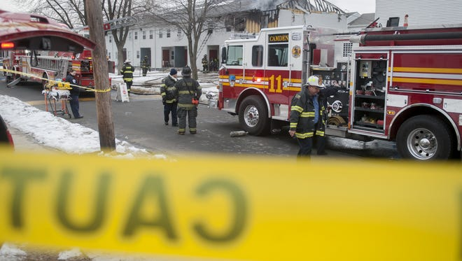 Officials respond to a fire at the Centennial Village Apartments in Camden on Thursday afternoon.