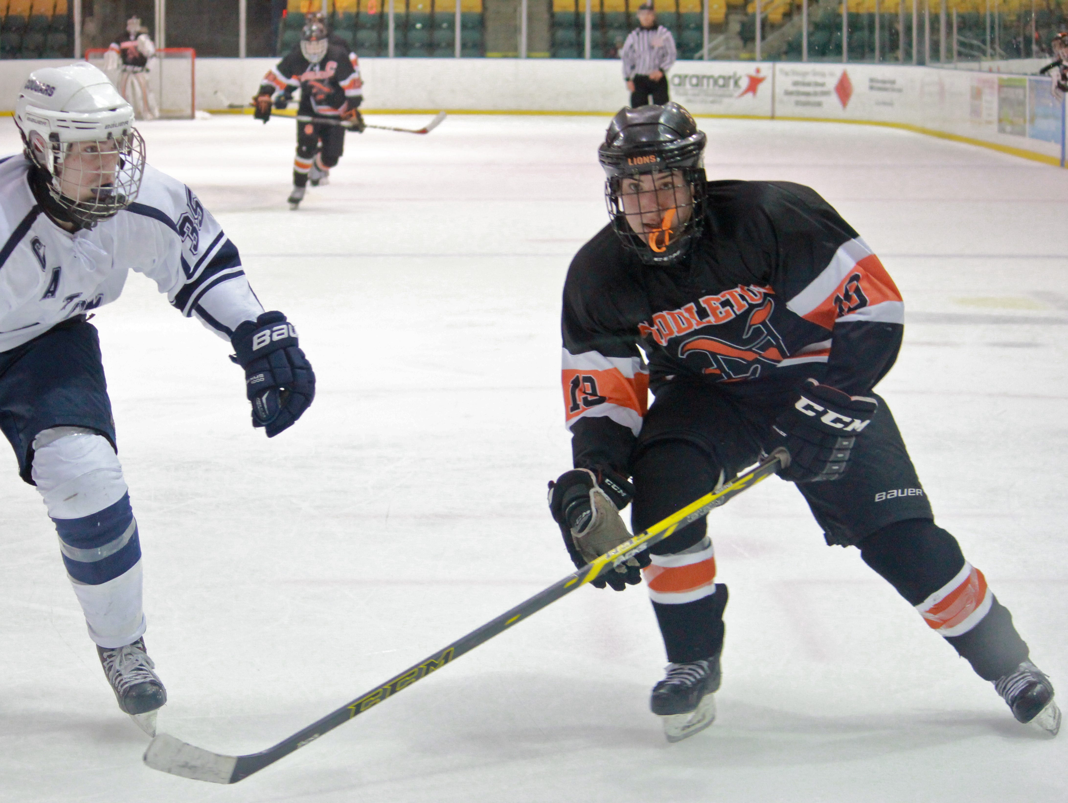 Kevin Felice (19 - right) seen skating in an NJSIAA Tournament game against Chatham led the Lions past Marlboro on Saturday.