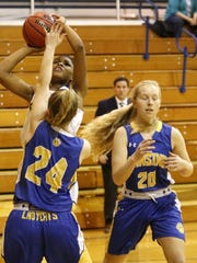Kahlia Rivera of Notre Dame puts up a shot as Lansing's