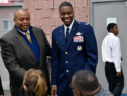 Abilene Mayor Anthony Williams and 7th Bomb Wing commander Col. Brandon Parker speak with diners at Abilene's Martin Luther King, Jr. banquet in January 2018. Parker is the first African-American commander of Dyess Air Force Base.