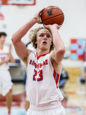Arrowhead senior Chandler Pulvermacher (23) shoots from the line during the game at home against Catholic Memorial on Friday, Feb. 9, 2018.