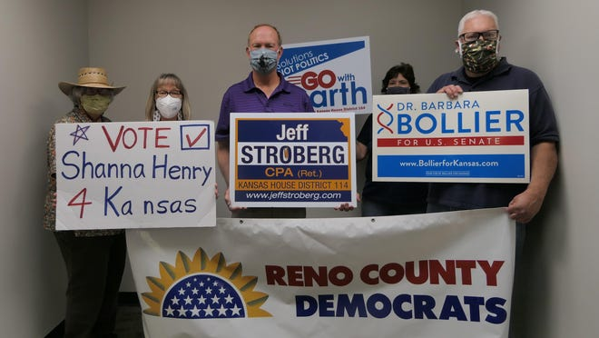 Reno County Democratic Party Election Headquarters representatives (L-R) Betty Taylor, President of Reno County Democratic Women; Shanna Henry, running for 34th district Kansas Senate; Jeff Stroberg; running for Kansas House -114th district; Gina Long, Reno County Democrat Party County Chair and Tim Henry open up their new offices at 115 W. 2nd St., Suite E on Friday.