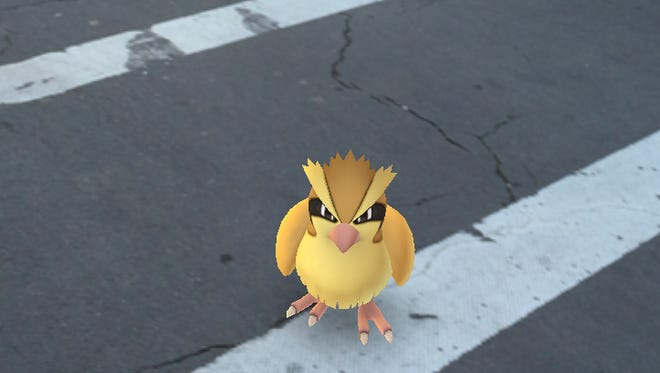 A Pokémon character in a crosswalk on Park Ave.
