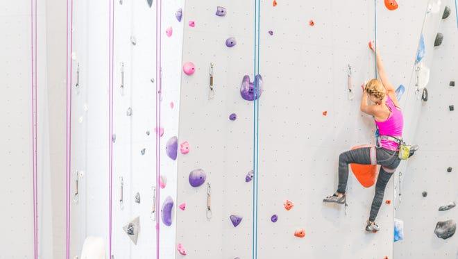 Julie Otis climbs at Mesa Rim.
