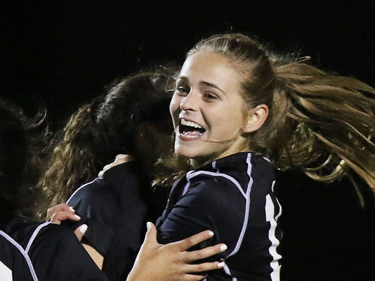 Claudia Dipasupil celebrates with Eva Hurm after Hurm scored Northern Highlands first goal in the second half.