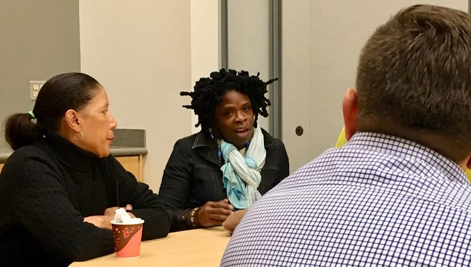 Jan-Michele Lemon Kearney (left) and Iris Roley are two of a dozen black community leaders meeting with United Way of Greater Cincinnati interim CEO Ross Meyer.