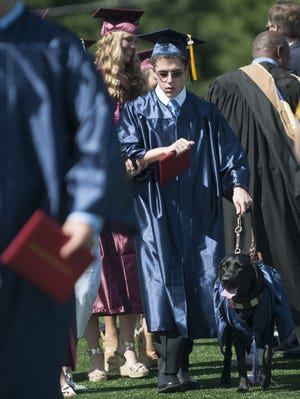Rocco Fiorentino, a blind member of Eastern High School's Class of 2014, walks with his guide dog named Glamour after Fiorentino received his diploma during the Eastern High Schoolâ??s Graduation ceremony held at Eastern High School in Voorhees on Friday.  06.20.14