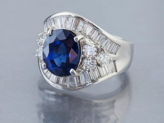 Natural sapphire; 2.20 carat total weight baguette and round diamonds; platinum ring. $15,995 from Diamond Vault Reno.