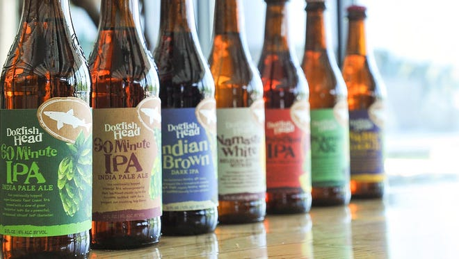 Dogfish Head's new, consistent bottle design, as shown on the first beers the craft brewer is releasing in the new packaging.