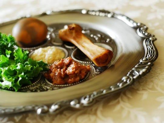 The traditional seder plate includes shank bone, egg, bitter herbs, vegetable and haroset (fruit paste).