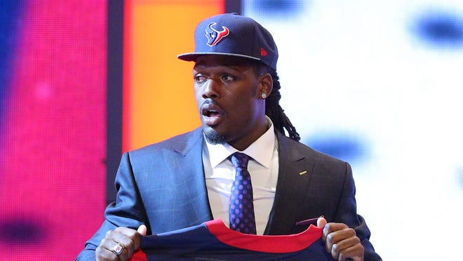 Jadeveon Clowney (South Carolina) holds a jersey after being selected as the number one overall pick in the first round of the 2014 NFL Draft to the Houston Texans at Radio City Music Hall.
