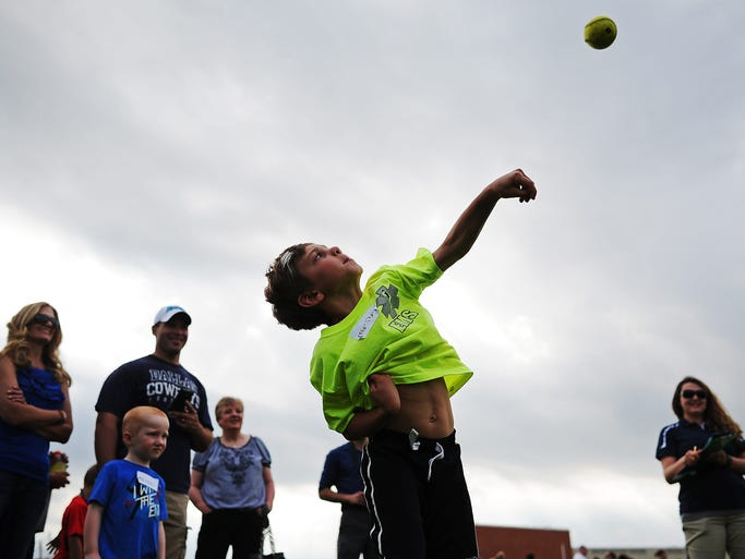Grady Ramos, 6, of Sioux Falls, throws during the Softball Throw during a First Premier Bank Summer Track Meet on Wednesday, June 11, 2014, at Lincoln High School in Sioux Falls.
