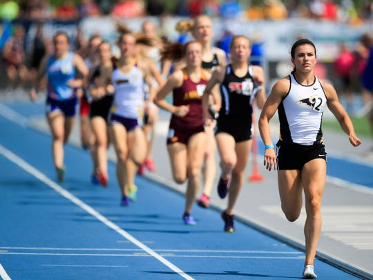 Sydney Milani of Southeast Polk leads the girls 4A 800 meter at the Iowa State Track & Field Championship Saturday, May 19, 2018.