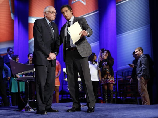 Democratic presidential candidate Sen. Bernie Sanders, I-Vt., left, speaks with host Chris Cuomo at a CNN town hall Monday night at Drake University in Des Moines, Iowa.