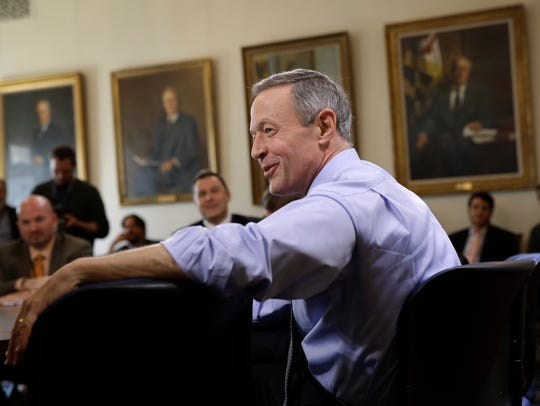 Martin O'Malley speaks with reporters during a roundtable