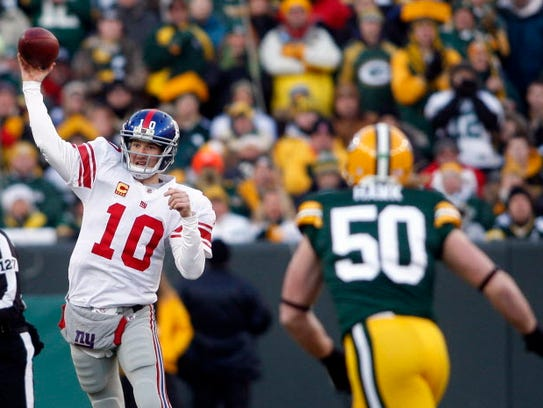 Eli Manning directed two playoff upsets of the Packers