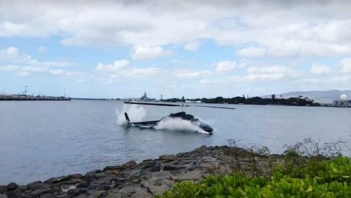 FILE - In this Thursday, Feb. 18, 2016 file image taken from video provided by Shawn Winrich, a helicopter crashes near Parl Harbor, Hawaii. A 16-year-old passenger died Monday after being injured last week in a Pearl Harbor helicopter crash, hospital officials said.