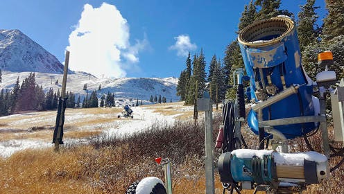 FILE - In this Nov. 2, 2016, file photo, a snow gun sits on an expanse of brown grass near the top of the Black Mountain Express run at Arapahoe Basin Ski Area near Keystone, Colo. Autumn snow has been scarce in the Rocky Mountains, forcing some ski areas to push back opening day and raising concerns about how much water will be available next spring for the Colorado River. But the first big storm of the season is expected to blow into Colorado and Utah on Thursday, Nov. 17, 2016.