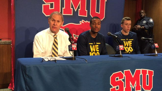 From left, Michigan coach John Beilein,  Muhammad-Ali Abdur-Rahkman and Duncan Robinson talk to the media after the Wolverines' 82-58 loss to host SMU on Tuesday, Dec. 8.