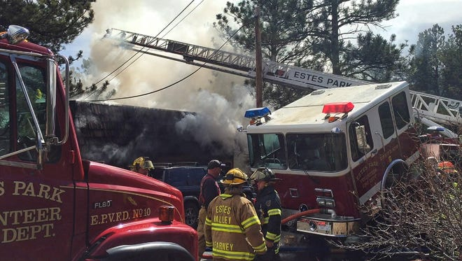 A residential fire in Estes Park forced 20 people from their homes Friday morning.