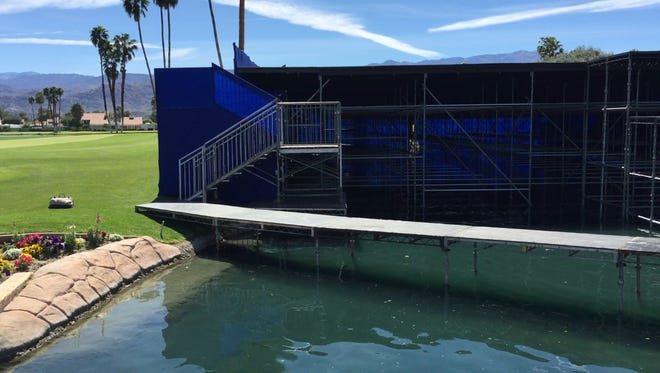 Workers build a new, larger viewing stand on the 18th green of the DInah Shore Tournament Course at Mission Hills Country Club in Rancho Mirage, home of the ANA Inspiration LPGA championship.