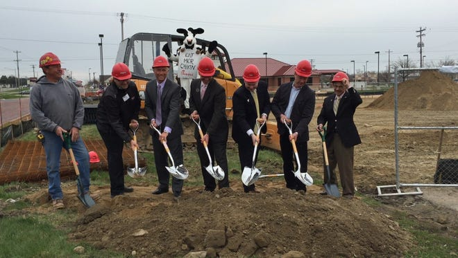 Officials from Chick-fil-A, Delta Township, Lansing and the Lansing Regional Chamber of Commerce break ground at the new Chick-fil-A location in Delta Township.