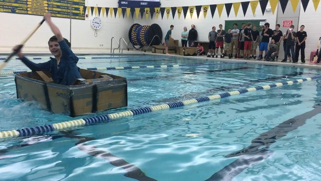Students at Delta Middle School test out the cardboard boats they made April 20 in the high school pool.