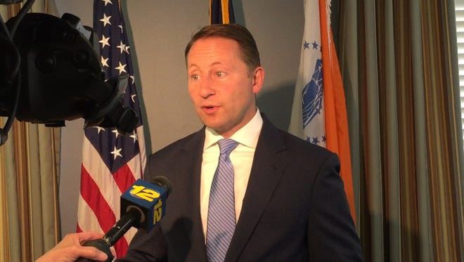 County Executive Rob Astorino speaks to members of the press after the county Industrial Development Agency voted to approve the sale of an Austin Avenue property on Thursday.