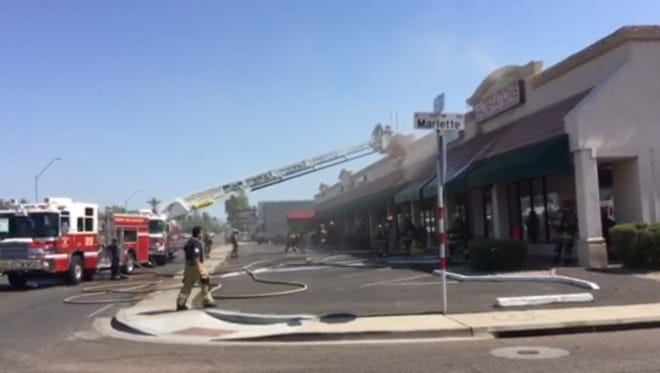 Phoenix fire crews contained a strip mall fire Saturday morning.