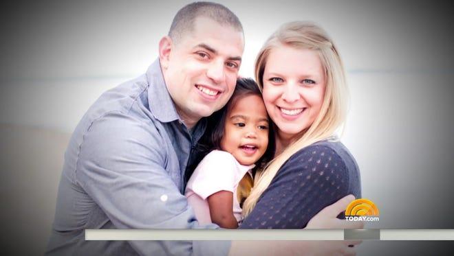 Ian and Jendi Sansoni hug their daughter Mylania.