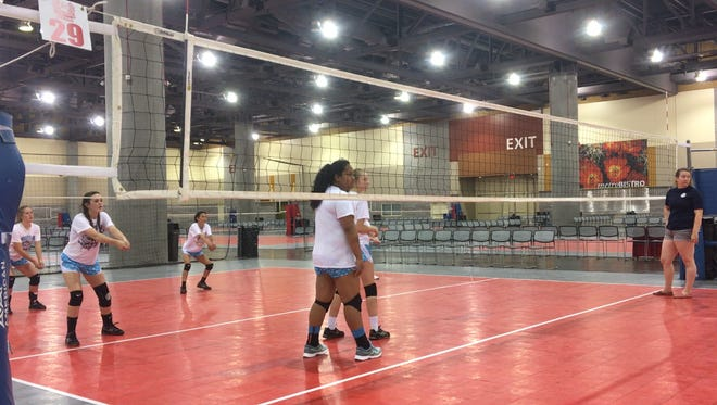 Players from Midnight Sun Volleyball Club's 14s team and coach Courtney Brewer practice for the 33rd Volleyball Festival International Championships.