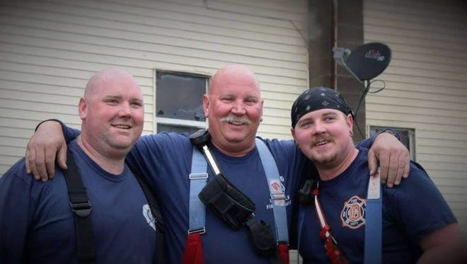 Ingham Township Fire Chief Tim Whipple, who died Saturday at 55, is flanked by his sons, Brandon (left) and Craig. Both sons work for the Ingham Township Fire Department.