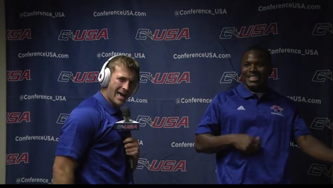 Louisiana Tech wide receiver Trent Taylor, left, sings karaoke with safety Xavier Woods on Monday at Conference USA Media Days.