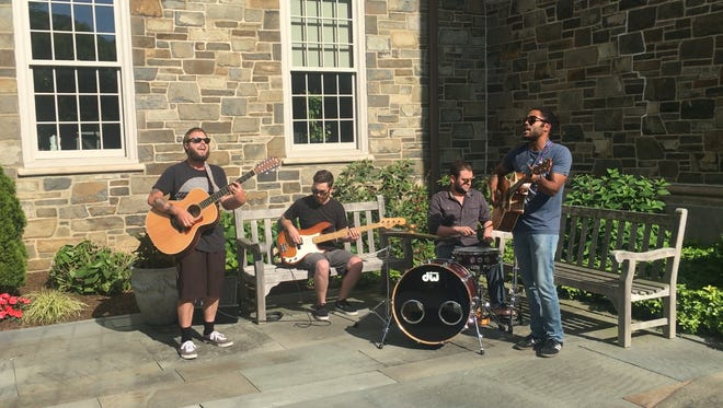 Karma Darwin performing during the Poughkeepsie Journal Patio Sessions.
