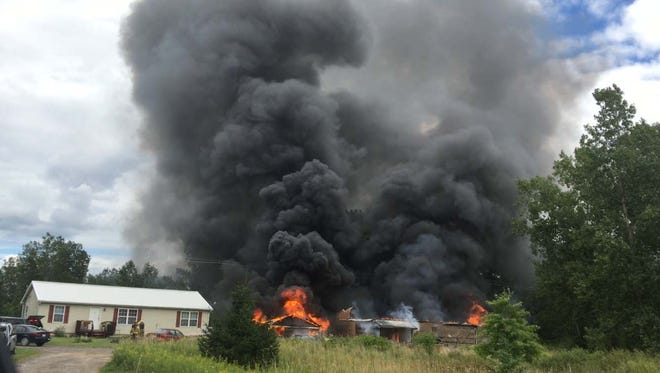 Fire destroyed two barns in the 6800 block of Owosso Road at 2:50 p.m. Sunday in Howell Township.