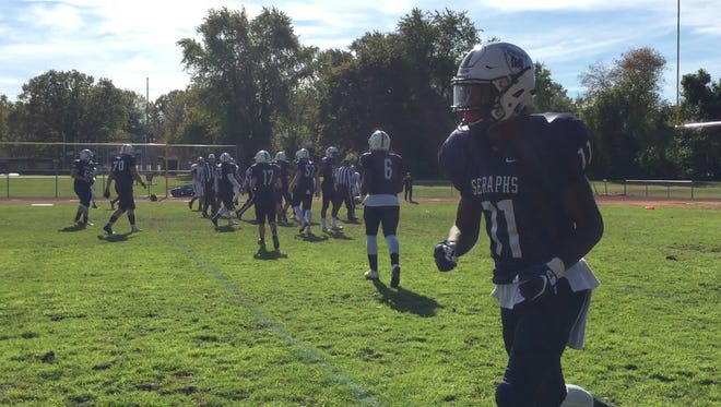 Eddie Lewis (11) helped Mater Dei Prep to a 41-0 win over South River Saturday.