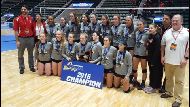 The Penfield girls volleyball team poses with the state championship trophy on Sunday.