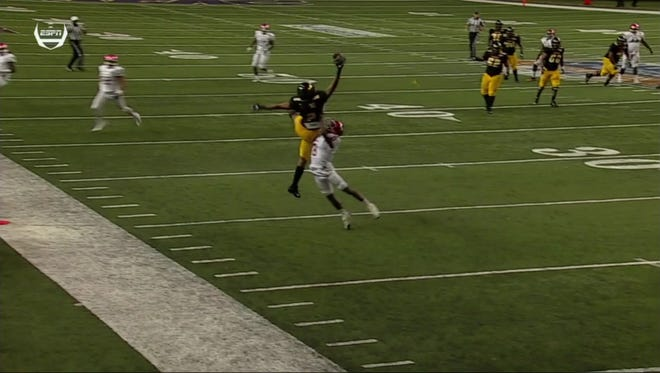 Grambling wide receiver Verlan Hunter makes a one-handed grab in the Tigers' Celebration Bowl victory over North Carolina Central.
