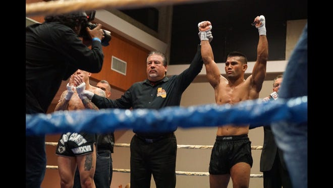 Guam-born and Guam-raised Joe Gogo, right, is declared the winner by unanimous decision after his WKC muay thai fight on March 11 in San Diego. The 28-year-old, 135-pound fighter beat Anthony Castrejon.