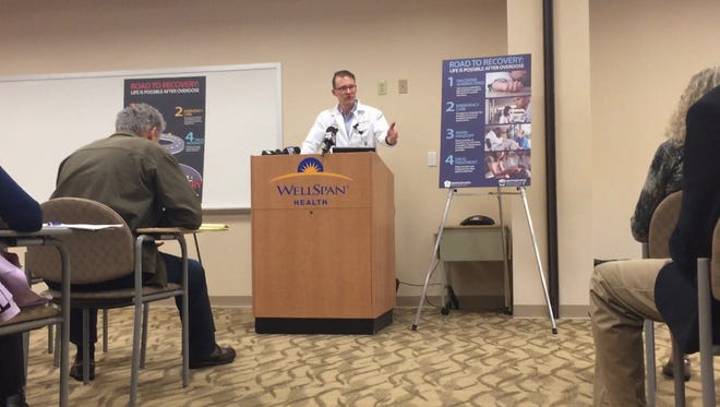 Dr. Erik Kochert, interim director of emergency medicine at York Hospital, speaks during a Tuesday news conference about a program that links people addicted to heroin to treatment.