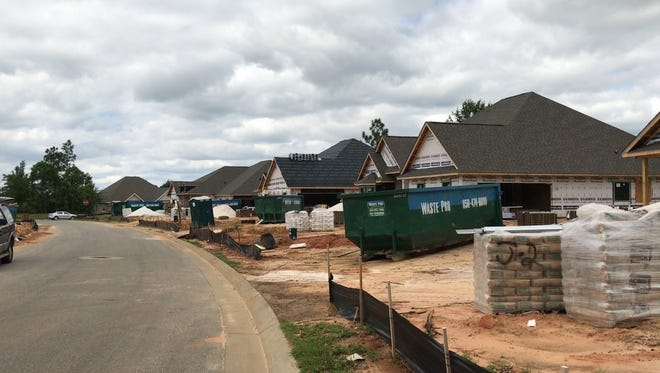 A row of homes is under construction at a subdivision in Milton on Monday, April 24, 2017.