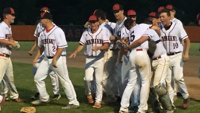 Wapahani celebrates its regional title after beating Lafayette Central Catholic 6-4 at Wabash High School.