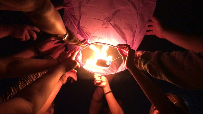 Rise to Remember honored loved ones who have been bullied or attempted or completed suicide. A lantern lighting June 7 lit floating lanterns to honor those loved ones.