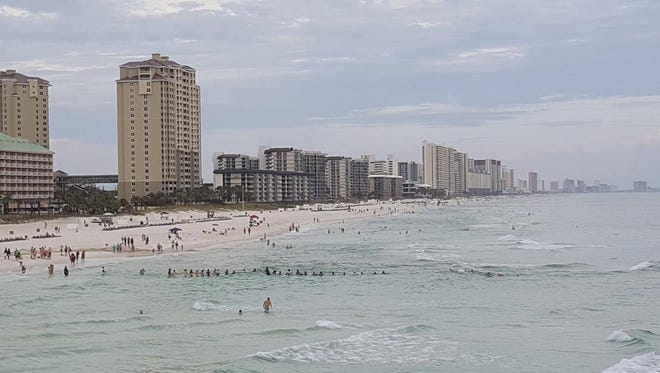 Beachgoers band together to save a family from drowning at Panama City Beach in Florida on July 8, 2017.