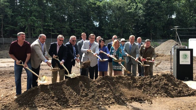 County Executive Cheryl Dinolfo stood alongside zoo officials and representatives of local construction companies as they broke ground on Phase 1 of a 10-year master plan for improvements.
