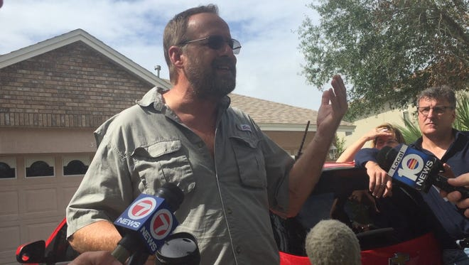 Eric Paddock talks to reporters outside his East Orlando home Tuesday. His brother, Stephen Paddock, has been identified by police at the gunman who killed 59 people and injured hundreds more.