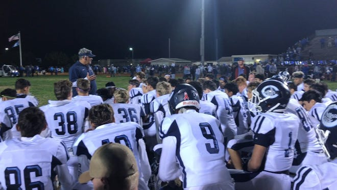 Camarillo High football coach Jack Willard speaks to his team after the Scorpions fell 42-17 at Lompoc in the first round of the CIF-Southern Section Division 3 playoffs.